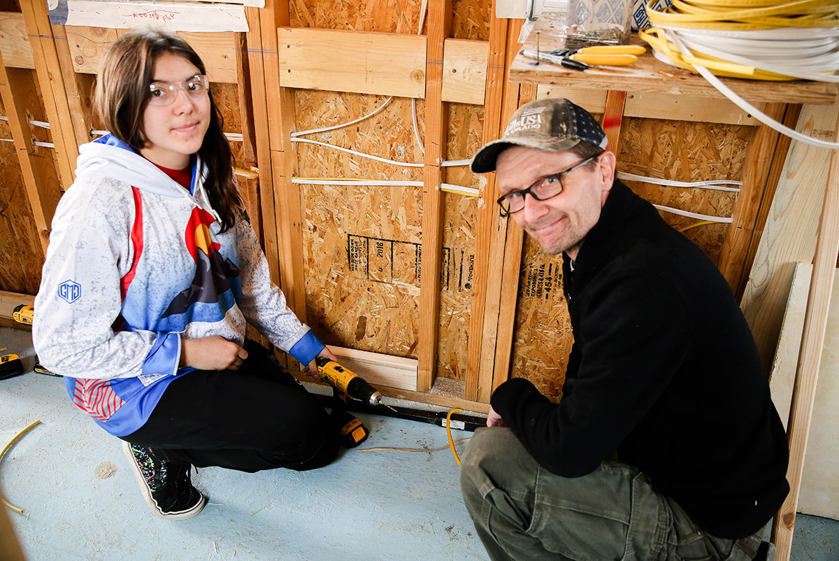 Student and teacher working on tiny home.